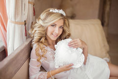 Beautiful smiling Bride Portrait wedding makeup, wedding hairsty. Le, Wedding dress. Wedding decoration. Gorgeous young woman at home Stock Photography