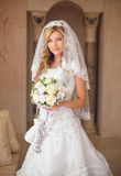 Beautiful smiling bride woman with bouquet of flowers, wedding m Royalty Free Stock Photos