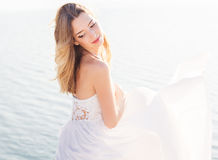 Beautiful smiling bride woman with flying dress Stock Image