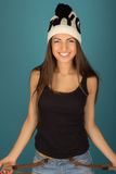 Beautiful smiling brown-haired woman in winter hat and jeans Stock Images