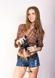 Beautiful smiling brunette girl with a camera Royalty Free Stock Images