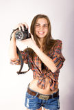 Beautiful smiling brunette girl with a camera Stock Photo