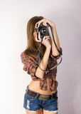 Beautiful smiling brunette girl with a camera Stock Image