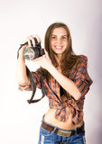 Beautiful smiling brunette girl with a camera Royalty Free Stock Image