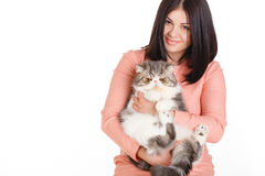 Beautiful smiling brunette girl and her big cat on a white background Royalty Free Stock Images