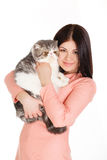 Beautiful smiling brunette girl and her big cat on a white background Stock Photo