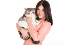 Beautiful smiling brunette girl and her big cat on a white background Stock Photos