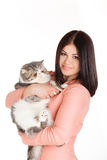 Beautiful smiling brunette girl and her big cat on a white background Royalty Free Stock Image