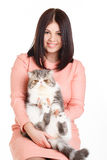Beautiful smiling brunette girl and her big cat on a white background Royalty Free Stock Photos