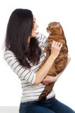 Beautiful smiling brunette girl and her ginger cat over white background Royalty Free Stock Photos