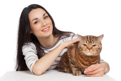 Beautiful smiling brunette girl and her ginger cat over white ba Royalty Free Stock Photo