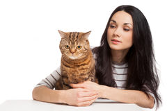Beautiful smiling brunette girl and her ginger cat over white ba Stock Images