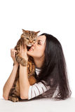 Beautiful smiling brunette girl and her ginger cat over white ba Royalty Free Stock Image