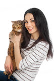 Beautiful smiling brunette girl and her ginger cat Royalty Free Stock Photo