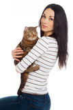 Beautiful smiling brunette girl and her ginger cat Royalty Free Stock Photos