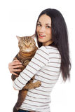 Beautiful smiling brunette girl and her ginger cat Stock Images