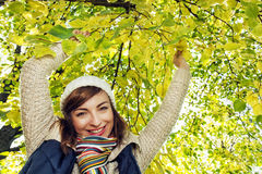 Beautiful smiling brunette posing under the beech tree in autumn Stock Images