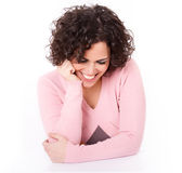 Beautiful Smiling Brunette Resting on her Elbows Stock Photo