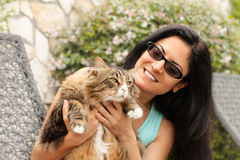 Beautiful smiling brunette Woman With Maine Coon C Stock Images