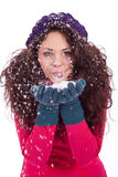 Beautiful smiling brunette woman in snow in winter Royalty Free Stock Image