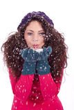 Beautiful smiling brunette woman in snow in winter Stock Photos