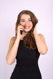 Beautiful smiling business woman have an emotion talking on the phone Stock Images