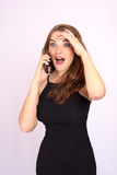 Beautiful smiling business woman have an emotion talking on the phone Stock Image