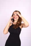 Beautiful smiling business woman have an emotion talking on the phone Stock Photo