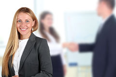 The Beautiful smiling business woman  portrait. handshake betwee Stock Photo