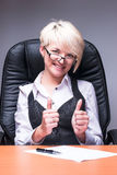 Beautiful smiling business woman shows thumb up Stock Images
