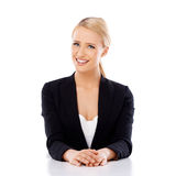 Beautiful smiling business woman sitting at the desk Stock Photo