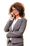 Beautiful smiling business woman talking at cell phone Stock Photos