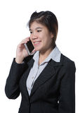 Beautiful smiling business woman talking with mobile phone in her hand Royalty Free Stock Photos
