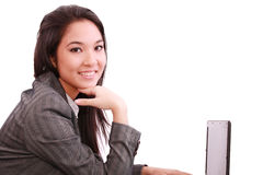 Beautiful smiling business woman working on laptop Stock Image