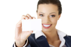 Beautiful smiling businesswoman with businesscard. Royalty Free Stock Images