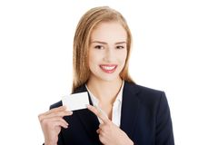 Beautiful smiling businesswoman with businesscard Stock Photo