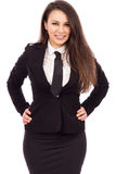 Beautiful smiling businesswoman with hands on hips Stock Images