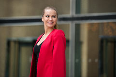 Beautiful smiling businesswoman looking to the side on the street.  Royalty Free Stock Photos