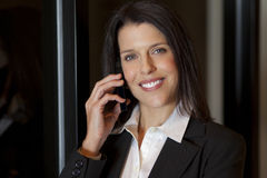 Beautiful smiling businesswoman talking on a cellphone Stock Photo