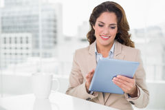 Beautiful smiling businesswoman using tablet Royalty Free Stock Images