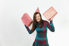 Beautiful caucasian young happy people on white background isolated. Holiday, party concept. Beautiful smiling caucasian fun young happy woman in plaid dress Royalty Free Stock Image