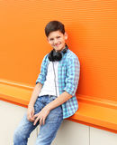 Beautiful smiling child boy wearing a shirt and headphones Royalty Free Stock Photos