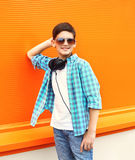 Beautiful smiling child boy wearing a sunglasses and headphones Stock Images