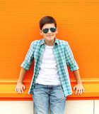 Beautiful smiling child boy wearing a sunglasses and shirt Stock Images