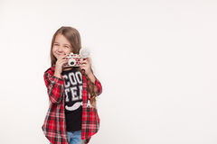 Beautiful smiling child girl holding a instant camera Royalty Free Stock Photo