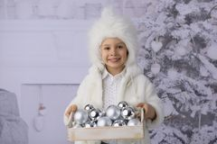 A child with Christmas presents and Christmas tree. stock image