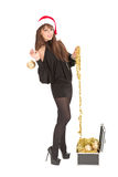 Beautiful smiling christmas santa woman. With gold ball Royalty Free Stock Photo