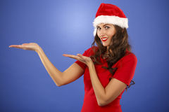 Beautiful smiling christmas santa woman pointing up showing copy Stock Photography