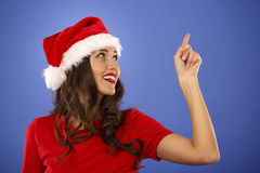 Beautiful smiling christmas santa woman pointing up showing copy Royalty Free Stock Photo