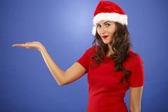 Beautiful smiling christmas santa woman pointing up showing copy Royalty Free Stock Image